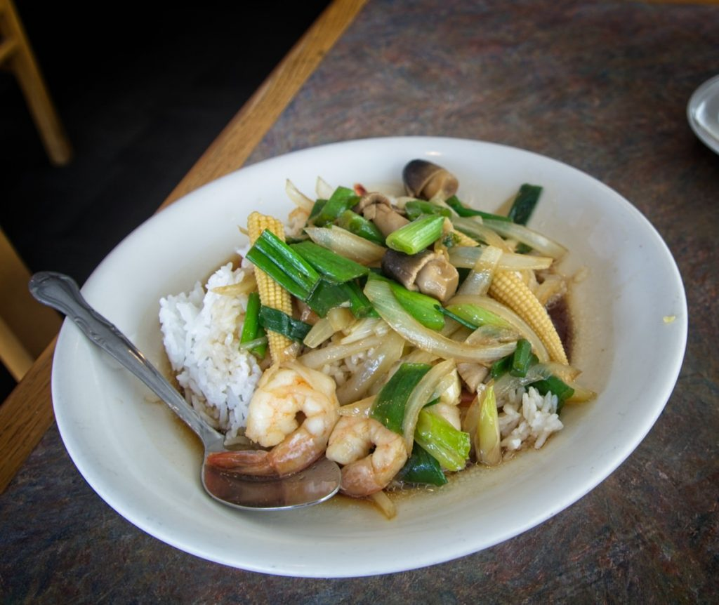 shrimp stir fried with green vegetables, served over sticky rice